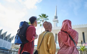 group-of-asian-muslim-tourists-enjoying-the-view-of-city-mosque-picture-id1265026190